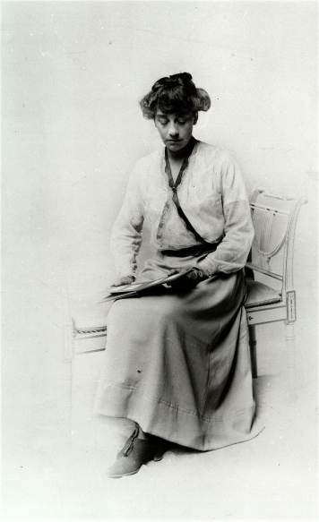 Photograph        of Violet Needham as an adult, posed reading